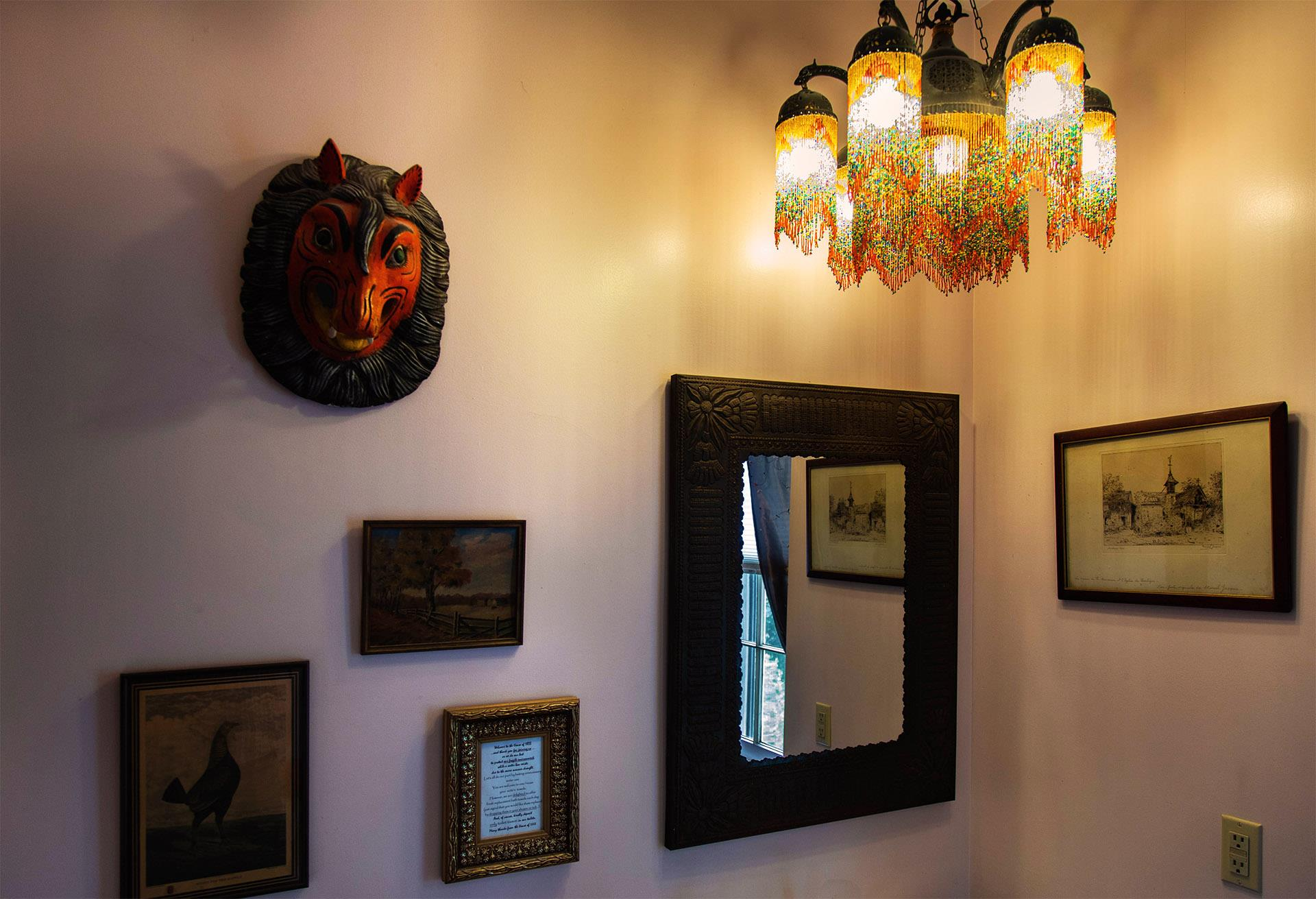 wall-with-antique-mask-and-pictures.jpg
