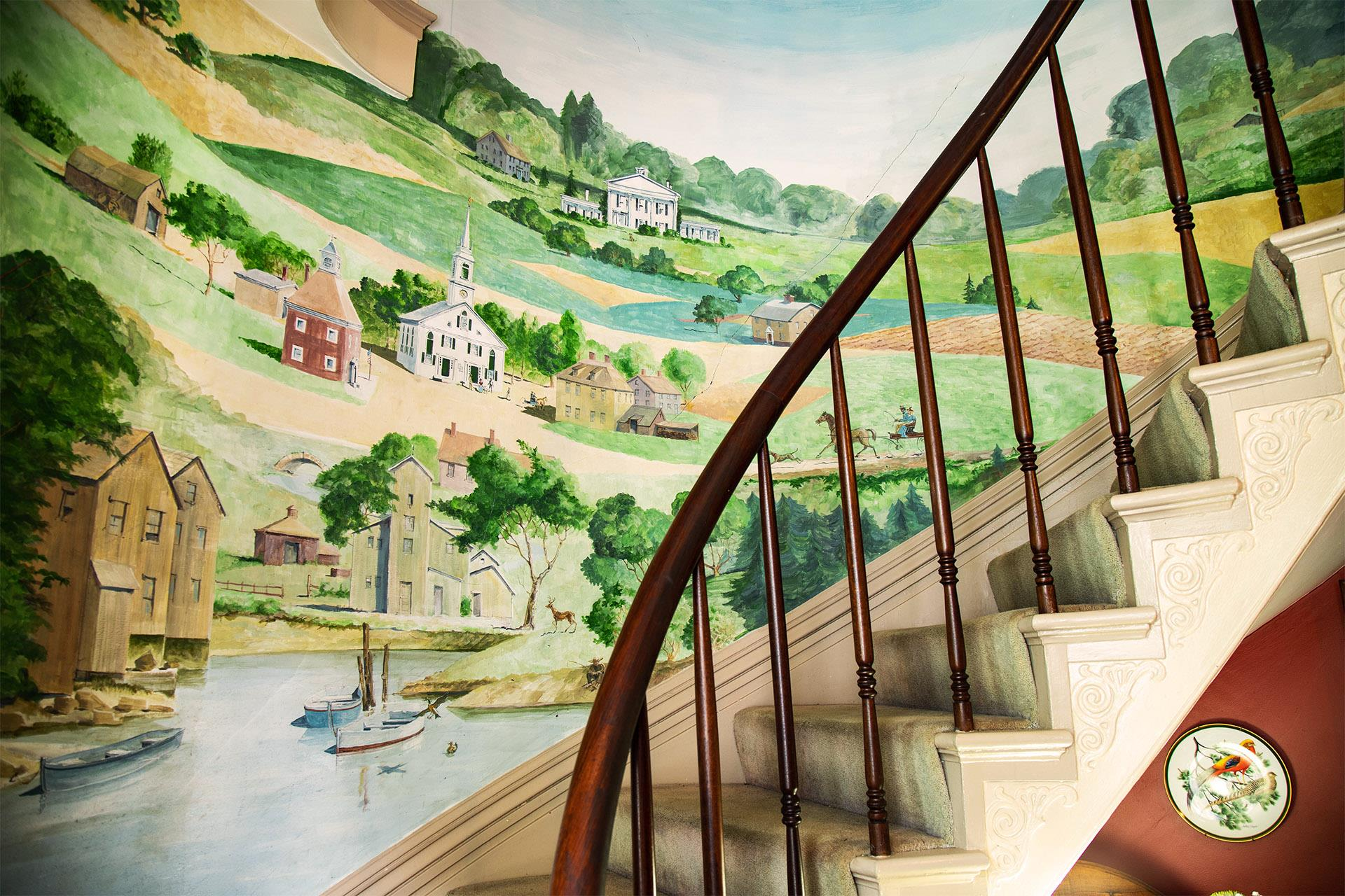 colorful-mural-on-wall-of-staircase.jpg