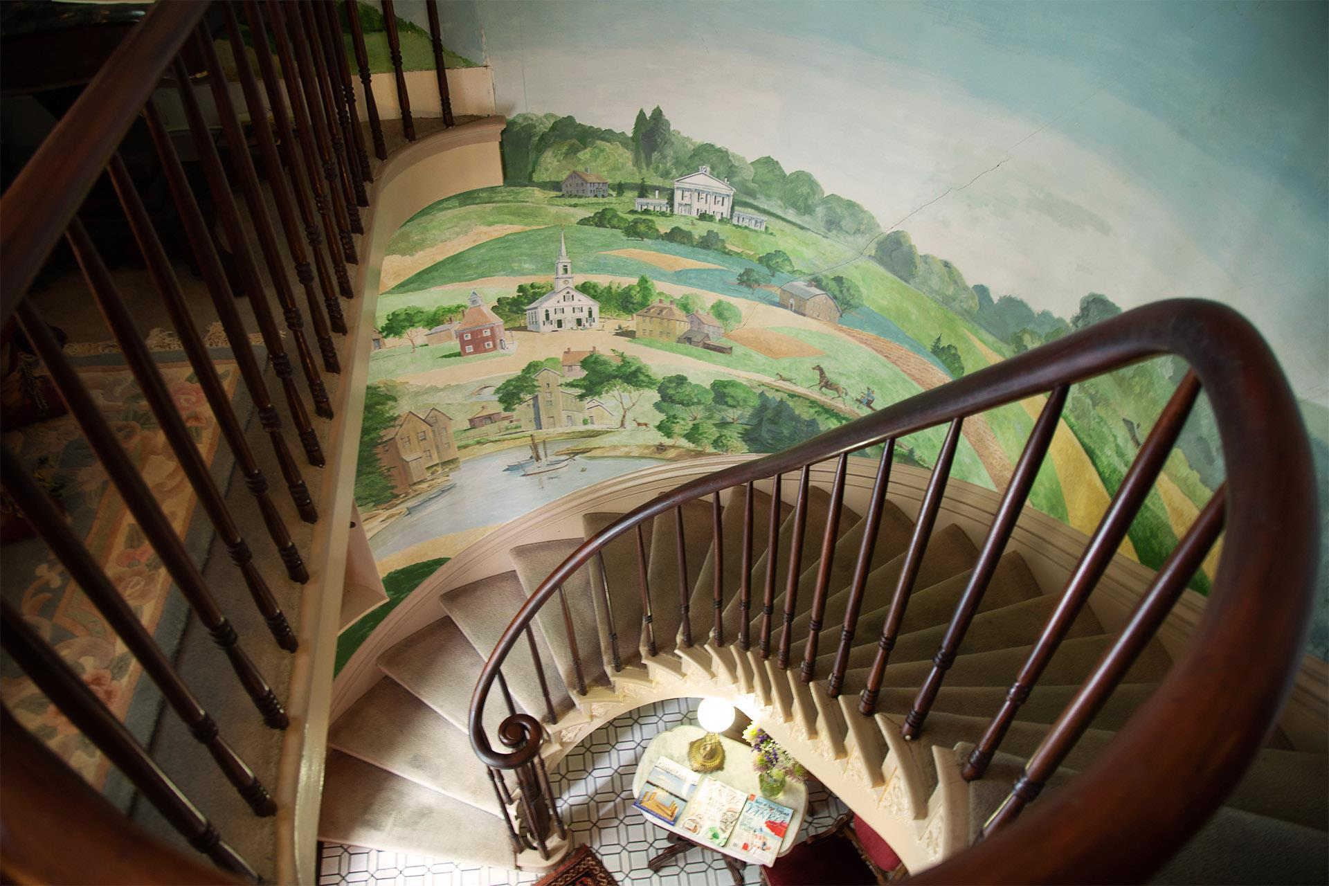 circular-staircase-with-mural-of-town